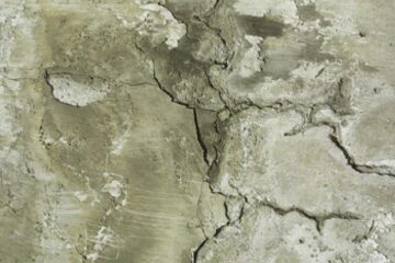 Concrete wall cracks with drywall