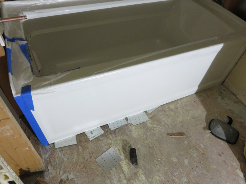 how tot level a bathtub with shims