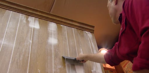 applying joint compound to wood paneling