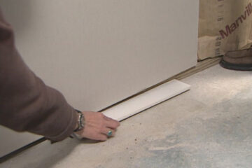 how far should drywall be off the floor